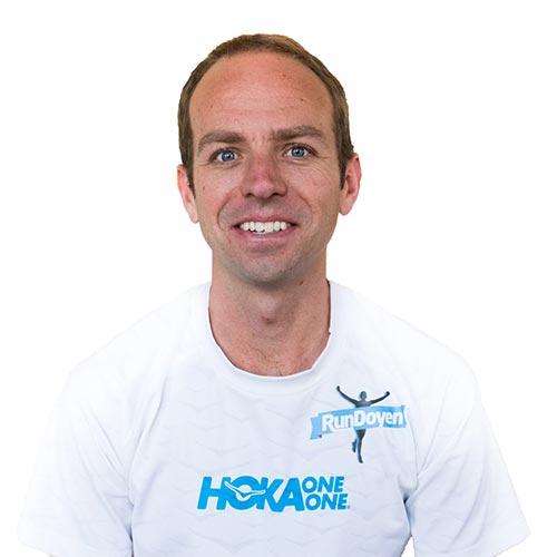 Aaron Braun wearing RunDoyen Coach Shirt