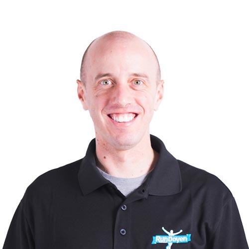 Alan Webb wearing RunDoyen Coach Shirt